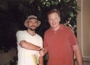 "Jon Niccum, left, and Conan O'Brien ""ink a big business deal"" in Beverly Hills, Ca., circa 1998."