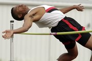 "Lawrence High junior Scottie Dunlap attempts to clear 5'10"" in the men's high jump Friday, May 14, 2010 at the Sunflower League Track and Field Championships."