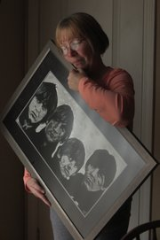 Sharon Wang admires a fellow fan's Beatles memorabilia. Her favorite Beatle in her high school days was Paul McCartney.