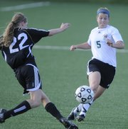 Free State midfielder Hillary Yoder and Olathe Northwest defender Renee Elsom fight for control of the ball during the first half of the game on May 18.