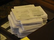 Stack of petitions opposed to provision aimed at stopping federal family planning funds from going to Planned Parenthood.