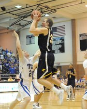 Zach Peters, right, elevates to take a jump shot.