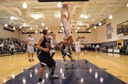 Zach Peters of Prestonwood Christian Academy in Plano, Texas, skies for a dunk.