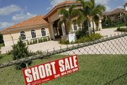A new $1.1 million, 5,200-square-foot home in Davie, Fla., is offered for short sale in this May 13 photo. The number of homeowners who missed at least one payment on their mortgage surged to a record in the first quarter of the year, a sign that the foreclosure crisis is far from over.