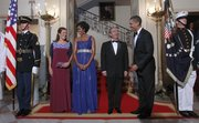 President Barack Obama and first lady Michelle Obama, with Mexican President Felipe Calderon and his wife Margarita Zavala, pose for the group photo Wednesday at the Grand Staircase before the start of the State Dinner at the White House in Washington.