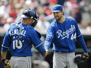 Kansas City starting pitcher Luke Hochevar (44) shakes hands with catcher Jason Kendall. Hochevar pitched the Royals to a 9-3 victory over the Indians on Thursday in Cleveland.