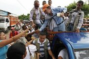 Santos greets supporters from the back of a truck during a campaign rally Thursday in Fundacion, northern Colombia. Colombia will hold presidential elections on May 30.