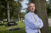 Bart Yost, funeral director for Rumsey-Yost Funeral Home, is pictured near his family plot at Oak Hill Cemetery. Yost joined the family business in the early 1980s with his father, Al Yost.