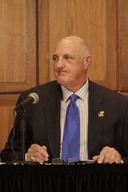 Lew Perkins, KU Athletic Director, prepares to take questions from members of the media after a report detailing improprieties in its ticket office was released to the public Wednesday afternoon. In the report, six employees of Kansas Athletics are described as taking part in a scheme to divert tickets and funds to their own benefit and away from KU.