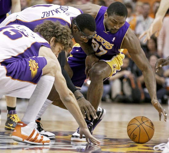 From left, Phoenix center Robin Lopez and forward Amare Stoudemire and Los Angeles forward Ron Artest battle for a loose ball. The Suns defeated the Lakers, 115-106, in Phoenix.