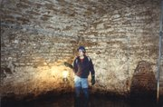 Free State Brewery's master brewer, Steve Bradt, during a 1997 expedition in the old Walruff Brewery tunnels — the first time people had explored them since they were sealed in 1964.