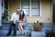Married for 7 months, Hai Nguyen, 37, and her husband, Jon Pope, 37, sit outside their home in Houston on Tuesday. They are part of a slowing trend of inter-ethnic marriage.