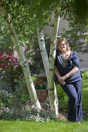 Karen McGrath has had to adapt her garden from sun to shade plants as her yard's trees have matured over the years.