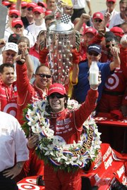 Dario Franchitti celebrates after winning the Indianapolis 500 Sunday at Indianapolis Motor Speedway in Indianapolis.