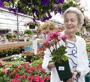 Cynthia Bryant, 73, pictured in a greenhouse near her home in Denver, shares many Americans' stress about debt, despite the economic recovery.