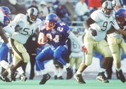 Former Jayhawk standout Tony Sands (24) makes one of his 58 carries (for 396 yards) against Missouri on a memorable day — Nov. 23, 1991, at Memorial Stadium.