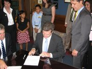 U.S. Sen. Sam Brownback, R-Kan., files paperwork on Tuesday to run for governor. Standing beside Brownback is his lieutenant governor running mate, state Sen. Jeff Colyer, R-Overland Park.