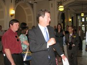 U.S. Sen. Sam Brownback, R-Kan., heads to podium Tuesday to speak with supporters during stop in Topeka.
