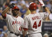 Los Angeles' Torii Hunter (48) celebrates his home run with teammate Mike Napoli in the seventh inning. The Angels beat the Royals, 7-2, Wednesday in Kansas City, Mo.