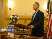 Attorney General Steve Six at the podium Thursday in the Old Supreme Court Room in the Statehouse announces his bid to retain his office.