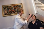"Community Exchange member Maria Villacreses, right, uses ""time dollar"" credits at home in Allentown, Pa., on her wedding day for makeup services from fellow exchange member Marilyn Shive in this May 15 photo. As the economy recovers amid high unemployment numbers the ancient practice of barter is becoming more popular nation wide through time banking, an exchange of volunteer service for ""time dollars,"" credit used for other services offered by members."