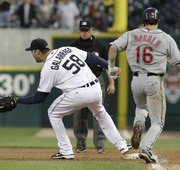 Detroit pitcher Armando Galarraga (58) covers first base as Cleveland's Jason Donald, right, runs to the base and umpire Jim Joyce looks on. Joyce called Donald safe, costing Galarraga his bid for a perfect game with two outs in the ninth on Wednesday in Detroit.