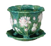 "This majolica jardiniere with water lilies is marked ""Minton."" It was made in the late 19th century. The bowl is 9 3/4 inches in diameter and sold for $633 at a Brunk auction in Asheville, N.C."