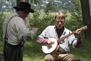 Daniel Steilley, 13, left, of Overland Park, plays the rhythm bones while Carl Anderton, of Merriam, plays the five-string banjo Saturday at the 154th anniversary of the Battle of Black Jack near Baldwin City.