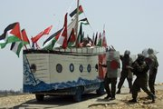 Israeli soldiers, right, try to stop a vehicle decorated in a shape of a ship by Palestinian, Israeli and international protesters. The vehicle depicting one of the ships of the humanitarian flotilla that tried to get to Gaza this week was used during a protest Friday in the outskirts of the West Bank village of Bilin, near the city of Ramallah.Tensions are high in the aftermath of an Israeli naval raid targeting the aid flotilla to Gaza that killed nine pro-Palestinian activists, mostly Turks, in the ensuing clash.