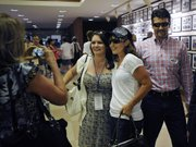 Former Alaska Gov. Sarah Palin poses for a photo as her husband, Todd Palin, right, stands behind her. The Palins attended the Belmont Stakes on Saturday in Elmont, N.Y. The horse First Dude, who finished third, is named for Todd Palin.