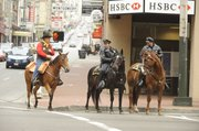 San Francisco Mounted Patrol officers Charlie Elllis and Sgt. Robert Totha escort Pony Express rider Jeff Babbage through downtown San Francisco. Babbage was the first rider on a journey to St. Joseph, Mo., celebrating the 150th anniversary of the Pony Express.