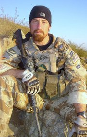 This photo provided by family shows Darren James LaBonte, 35, in Afghanistan in 2007. LaBonte was one of seven CIA employees who died when a suicide bomber blew himself up at a U.S. base in Khost, Afghanistan, on Dec. 30, 2009.