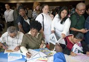 Job seekers line up to speak with potential employers during the ninth annual Skid Row Career Fair on Thursday at Los Angeles Mission in Los Angeles.