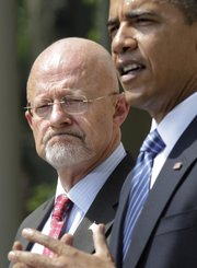President Barack Obama announces James Clapper, left, as Director of National Intelligence, his choice to oversee the nation's 16 spy agencies, during a ceremony Saturday in the Rose Garden at the White House in Washington.