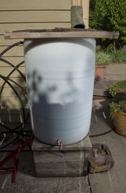 Mersmann and Gingerich also installed five rain barrels around the house to cut back on water usage.