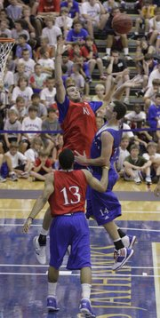 Blue team guard Tyrel Reed puts a floater over red team center Jeff Withey during the second half of a scrimmage at the Horejsi Center for Bill Self's annual basketball camp Wednesday, June 29, 2010.