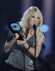"Carrie Underwood accepts the ""Video of the Year"" award Wednesday at the 2010 CMT Awards in Nashville, Tenn."