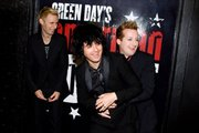 "Green Day members Mike Dirnt, Billy Joe Armstrong and Tre Cool arrive at the opening night performance of the Broadway musical ""American Idiot"" in New York, on April 20, 2010."