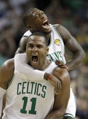 Boston Celtics forward Glen Davis (11) and guard Nate Robinson celebrate a scoring run against the Los Angeles Lakers. The Celtics won, 96-89, Thursday in Boston.