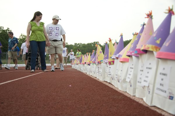 Deborah Bredehoft, left, and Tim Bredehoft, both of Lawrence, look at luminarias during Relay For Life of Douglas County held Friday, June 11, 2010, at the Free State High School track. They were walking in honor of Tim's mother.