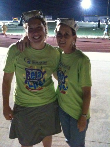 Christine Metz, left, and I pose for a photo about 3 a.m. Saturday at Relay For Life of Douglas County after attending the team captain's meeting. Our team's newspaper hats won an award for being the greenest.