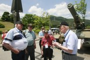 "Korean War veterans Henry F. Reed, 78, of Butte, Mont., left, and Lynn A. Freeman, 87, of Concord, Calif., right, talk as veterans of the 2nd Infantry Division and the 5th Regimental Combat Team, listen during a tour of a war monument June 2 at Dabu-Ri, South Korea. Some were among the troops who held out in mid-1950 on the last-ditch ""Pusan Perimeter,'' staving off final North Korean conquest of the south."