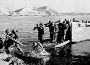 "Troops of the First U.S. Cavalry Division land ashore July 19, 1950, at Pohang on the east coast of Korea during the Korean War. The war that began in Korea 60 years ago, on June 25, 1950, a ghastly conflict that killed millions and left the peninsula in ruins, became ""The Forgotten War"" in many American minds."
