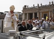 Pope Benedict XVI leaves after celebrating a Mass on Friday in St. Peter's Square concelebrated by 15,000 white-robed priests, all marking the end of the Vatican's Year of the Priest.