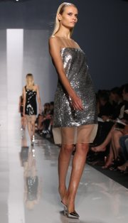 A model walks the runway in a metallic dress by Michael Kors during fashion week in New York, which was in September 2009.