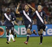 United States' Clint Dempsey, center, celebrates after scoring a goal in the World Cup Group C soccer match 