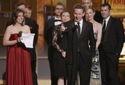"Author John Logan accepts the Tony Award for Best Play for ""Red"" during the 61st Tony Awards on Sunday in New York."