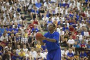 Kansas guard Tyshawn Taylor shoots three-pointers and free throws in front of campers at Bill Self's basketball camp on Monday at Horejsi Center.