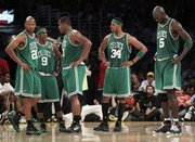 From left, Boston's Ray Allen, Rajon Rondo, Glen Davis, Paul Pierce and Kevin Garnett gather during a timeout in the second half. The Celtics were hammered, 89-67, by the Lakers on Tuesday in Los Angeles.