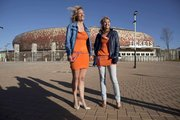 Barbara Castelein, left, and Mirte, both from the Netherlands, walk Tuesday outside the Soccer City stadium in Johannesburg. FIFA questioned more than 30 women who showed up for a World Cup match in orange mini-dresses that are the symbol of a Dutch beer advertising campaign.